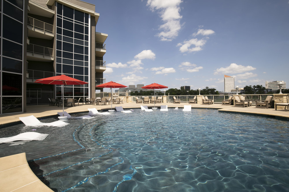Community pool and lounge area before editing with shadowed lighting